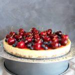 Baked Vanilla Cheesecake with Cherry Coulis. You won't believe how creamy & melt in your mouth this baked cheesecake is! It's super easy to make & absolutely perfect as a Christmas dessert | berrysweetlife.com