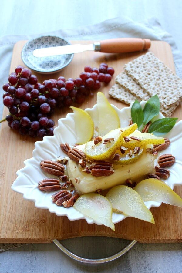 Cream Cheese Appetizer with Poached Pear & Toasted Pecans. A quick & easy recipe that looks and tastes incredible. Your friends & family will be so impressed! Perfect for any occasion | berrysweetlife.com