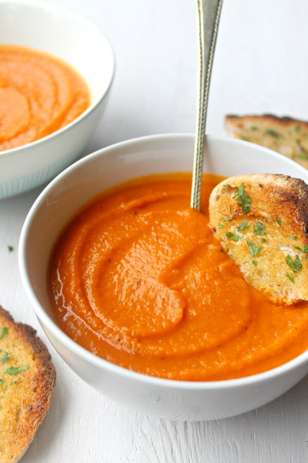 Cozy Up Tomato & Butternut Squash Soup. The perfect soup for a cozy night in! It's a quick & easy recipe packed with flavour that everyone will enjoy | berrysweetlife.com