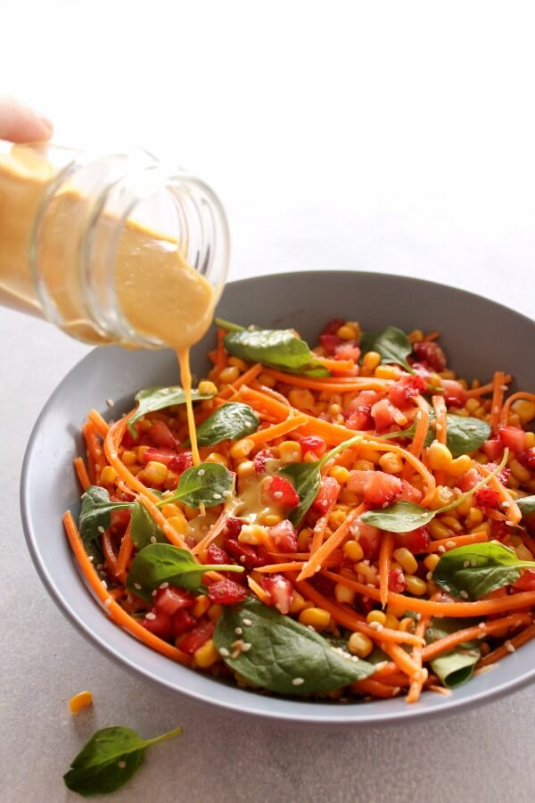 Asian Carrot Salad with Peanut Ginger Dressing. A crunchy, flavourful salad with a smooth, peanut dressing. The perfect light, healthy meal or delicious side dish for any occasion | berrysweetlife.com