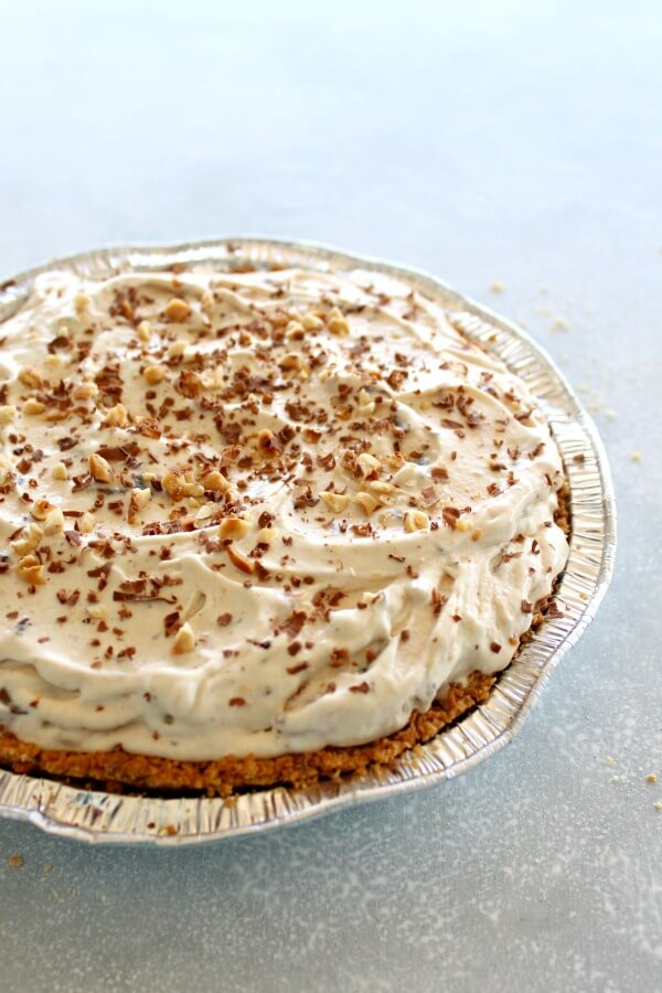 Chocolate Chip Peanut Butter Ice Cream Pie. An easy dessert and HEAVENLY Indulgence! Made with a tub of vanilla ice cream, nut butter, chocolate chips and a graham cracker crust, perfect for summer get togethers! | berrysweetlife.com