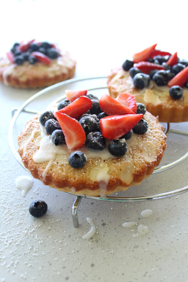 Mini Classic Berry Apricot Almond Tarts recipe - easy to make with ground almonds and shortcrust pastry for a tea time treat or a delicious French dessert! | berrysweetlife.com