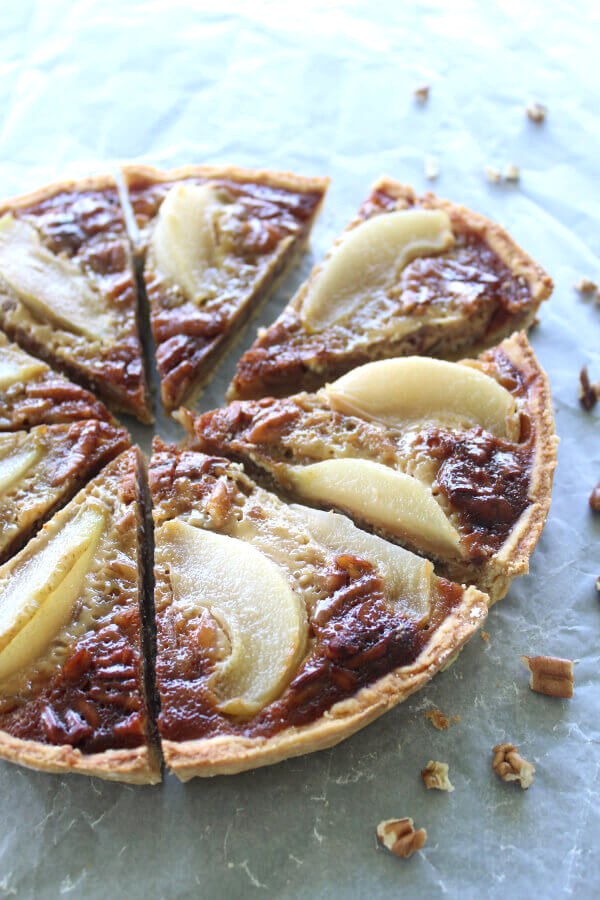 A Rich Caramel Pecan Pear Pie recipe that is the best I have ever had! Made with a buttery crust from scratch, poached pears and a creamy caramel filling | berrysweetlife.com