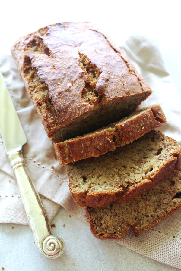 """A Completely Healthy Banana Bread recipe that is super moist and delicious! This recipe has no sugar, healthy fats, wholewheat flour, and is more """"banana with a little bread than bread with a little banana!""""   berrysweetlife.com"""